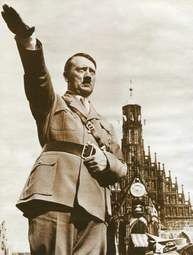 GERMANY, CIRCA 1945: Adolf Hitler saluting in Berlin in 1945 - one of his last photographs