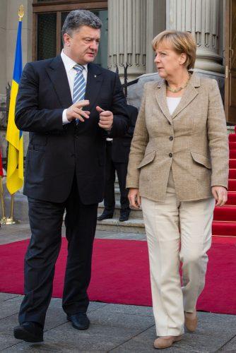 KIEV, UKRAINE - Aug 23, 2014: President of Ukraine Petro Poroshenko and Federal Chancellor of Germany Angela Merkel during a working visit to Ukraine